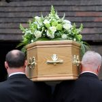 funeral directors with coffin